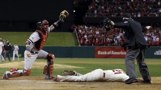 Boston Red Sox catcher Jarrod Saltalamacchia watches as home plate umpire Dana DeMuth calls St. Louis Cardinals' Allen Craig safe on an obstruction. (AP Photo/David J. Phillip)