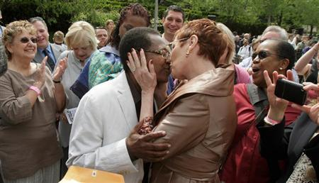 Vernita Gray (left) and Pat Ewart kiss after their marriage ceremony  (Reuters/John Gress)