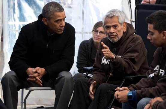 President Barack Obama listens to a hunger striker at the National Mall in Washington. (AFP/Nicholas Kamm)