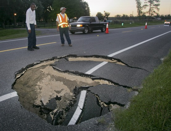 A sinkhole grows along Highway 129 South in Live Oak, Florida. (REUTERS/Phil Sears)
