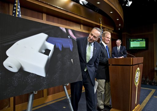 Sen. Chuck Schumer, D-N.Y., center, and Sen. Bill Nelson, D-Fla., arrive to talk to reporters about their effort to renew the ban on plastic firearms that can evade airport detection machines, at the Capitol in Washington, Monday. (AP Photo/J. Scott Applewhite)