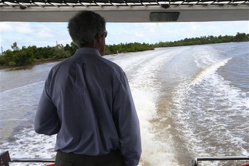 U.S. Secretary of State John Kerry rides a boat through the Mekong River Delta Sunday. (AP Photo/Brian Snyder, Pool)