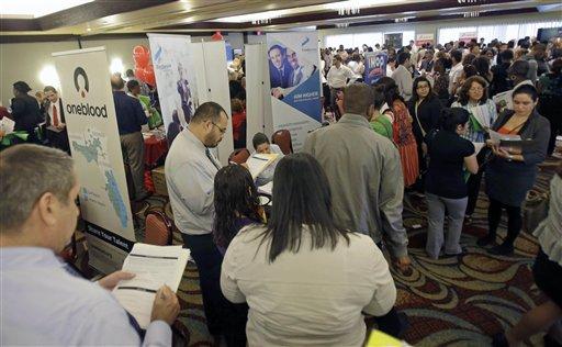Job seekers checking out companies at a job fair in Miami Lakes, Fla.  (AP Photo/Alan Diaz, File)