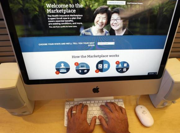 A man looks over the Affordable Care Act (commonly known as Obamacare) signup page on the HealthCare.gov website. (REUTERS/Mike Segar)