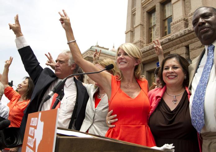 Wendy Davis and Leticia Van de Putte campaign at the State Capitol in Austin, TX (AP)