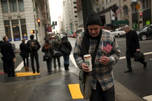 A homeless man begs for money in the Financial District in San Francisco. (REUTERS/Robert Galbraith)