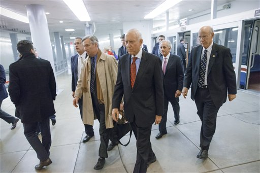 Republican lawmakers arrive at the Capitol as the Senate votes to approve a $1.1 trillion spending package at the Capitol in Washington, Thursday.  (AP Photo/J. Scott Applewhite)