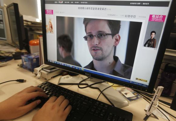 Edward Snowden, a contractor at the National Security Agency (NSA), Chinese news website, in Beijing. (REUTERS/Jason Lee )