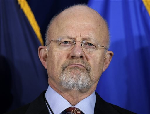 "Under Secretary of Defense for Intelligence James Clapper. Clapper called the disclosure of an Internet surveillance program ""reprehensible"" Thursday June 6, 2013 and said it risks Americans' security. (AP Photo/J. Scott Applewhite, File)"