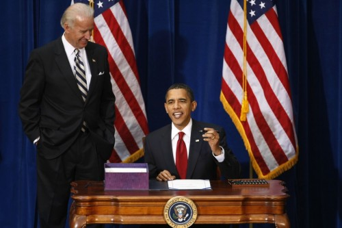 President Barack Obama says he has to use 10 pens as he signs the American Recovery and Reinvestment Plan as Vice President Joe Biden (L) looks on at the Denver Museum of Nature and Science in Denver, February 17, 2009.  (REUTERS/Rick Wilking)