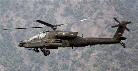 U.S. military AH-64 Apache assault helicopter.  (REUTERS/Erik De Castro)