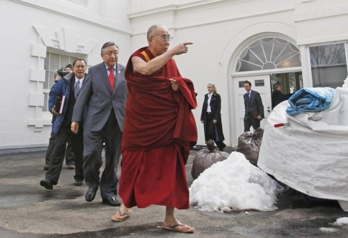 The Dalai Lama walks out of the White House in Washington, after meeting with President Barack Obama.  (AP Photo/Charles Dharapak)