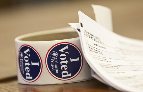 "A roll of ""I Voted"" stickers rests on a table near a voter registration list at the Old Train Depot in Denmark, South Carolina.  (REUTERS/Chris Keane)"