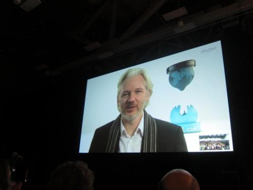 Fugitive WikLeaks founder Julian Assange speaks via Skype.  (AP Photo/Barbara Ortutay)