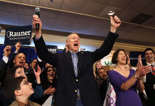Businessman Bruce Rauner, left, and his wife Diana.  (AP Photo/Charles Rex Arbogast)