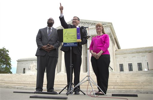 Rev. Dr. Rob Schenck, of Faith and Action, center, speaks in front of the Supreme Court with Raymond Moore, left, and Patty Bills, both also of Faith and Action, during a news conference, Monday, in favor of the ruling by the court's conservative majority.  (AP Photo/Carolyn Kaster)