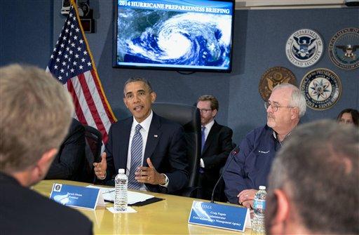 President Barack Obama speaks at Federal Emergency Management Agency (FEMA) headquarters in Washington, Friday, during a hurricane preparedness meeting. at right is Federal Emergency Management Agency (FEMA) administrator Craig Fugate.  (AP Photo/Carolyn Kaster)