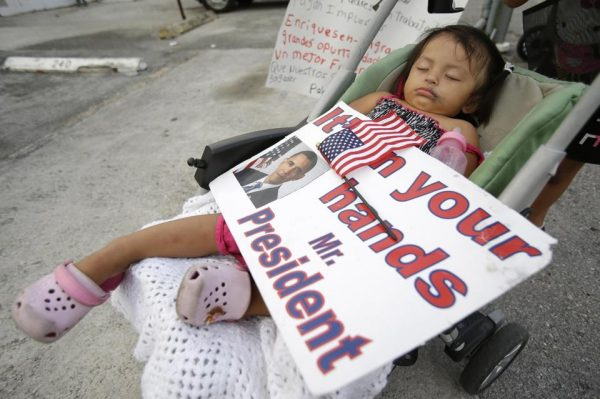 Diana Jimenez, 2, as she sleeps in a stroller during a rally sponsored by local immigrant rights organizations, in Homestead, Fla. Jimenez's father was deported to Guatemala two years ago (AP Photo, File)