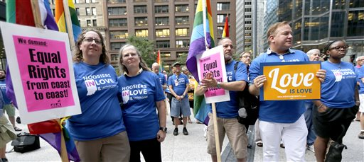 Supporters of gay marriage in Wisconsin and Indiana attend a rally at the federal plaza in Chicago  (AP Photo/Charles Rex Arbogast)