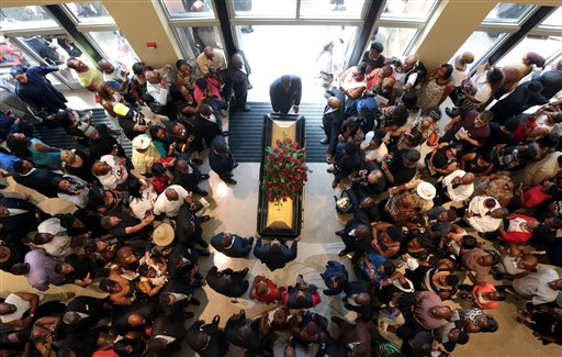 A casket containing the body of Michael Brown is wheeled out Monday  (AP Photo/St. Louis Post Dispatch, Robert Cohen, Pool)
