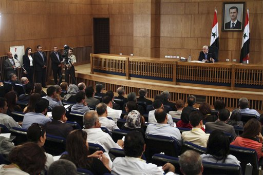 Syrian Foreign Minister Walid al-Moallem speaks during a press conference, giving the first public comments by a senior Assad official on the threat posed by the Islamic State group, in Damascus, Syria (AP Photo)