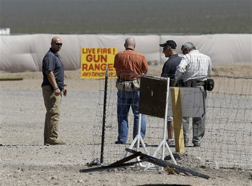 People are seen at the Last Stop outdoor shooting range in White Hills, Ariz. Gun range instructor Charles Vacca was accidentally killed Monday at the range by a 9-year-old with an Uzi submachine gun.  (AP Photo/John Locher)