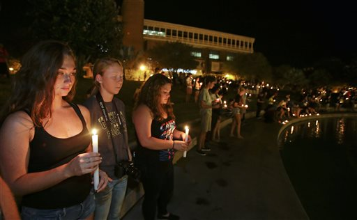 Students and supporters take part in a candle light vigil at the University of Central Florida (AP Photo/John Raoux)