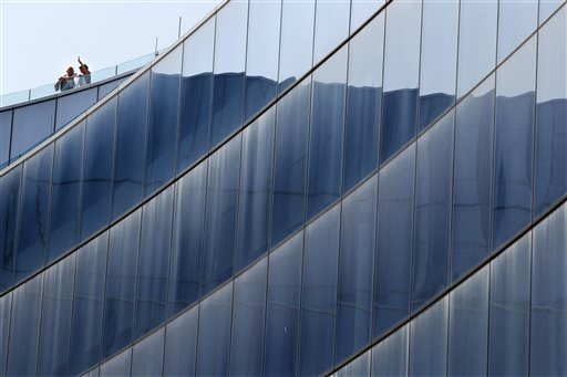 People stand on a high deck at Revel Casino Hotel in Atlantic City, N.J.  (AP Photo/Mel Evans)