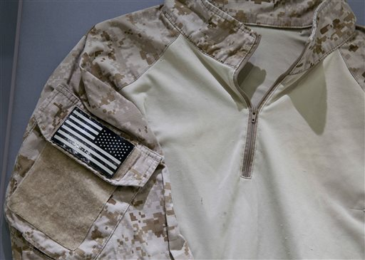 The fatigue shirt worn by a U.S. Navy SEAL during the mission to kill Osama bin Laden, (AP Photo/National September 11 Memorial and Museum, Jin Lee)