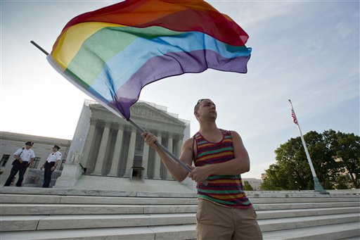 Gay rights advocate Vin Testa waves a rainbow flag in front of the Supreme Court  (AP Photo/J. Scott Applewhite)