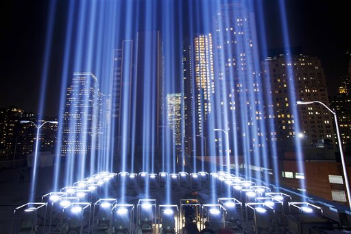The Tribute in Light rises above buildings in New York.   (AP Photo/Mark Lennihan)