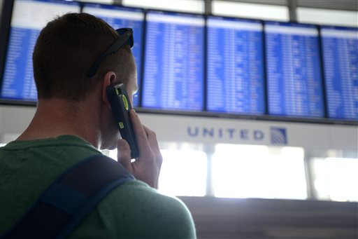 Dennis McCormack of Rockaway, N.J. checks the departure board only to find out that his flight to Newark, N.J. has been canceled at O'Hare International Airport in Chicago (AP Photo/Paul Beaty)