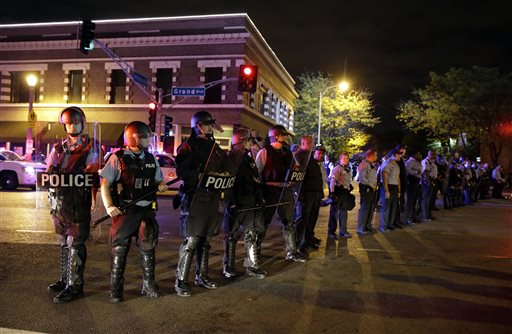 Police wearing riot gear form a line to contain protesters Thursday  (AP Photo/Jeff Roberson)