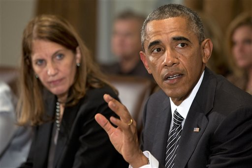 President Barack Obama, right, next to Health and Human Services Secretary Sylvia Burwell, speaks to the media about Ebola during a meeting in the Cabinet Room of the White House  (AP Photo/Jacquelyn Martin)