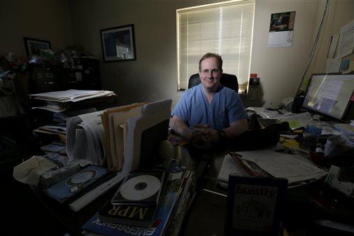 William Gluckman, president of FastER Urgent Care  (AP Photo/Julio Cortez)