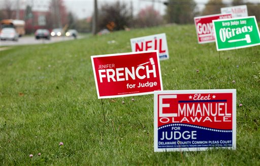 Political campaign signs near a state highway in Westerville, Ohio  (AP Photo/Columbus Dispatch, Fred Squillante)