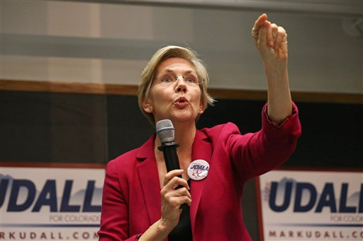 Sen. Elizabeth Warren, D-Mass., speaks to a crowd during a rally to urge the reelection of Colo. Sen. Mark Udall to the Senate, on the campus of the University of Colorado,  (AP Photo/Brennan Linsley)