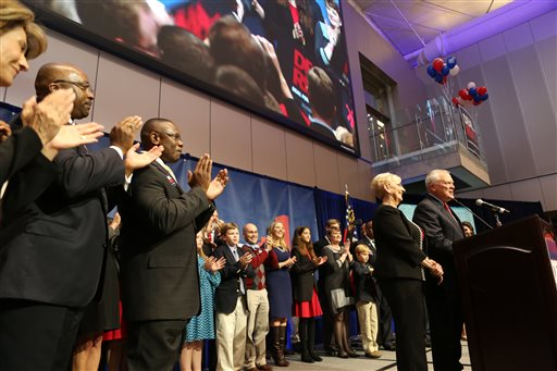 Georgia Gov. Nathan Deal speaks to his supporters as he wins re-election against Democratic opponent Jason Carter at the College Football Hall of Fame in Atlanta, Tuesday . (AP Photo/Akili-Casundria Ramsess)