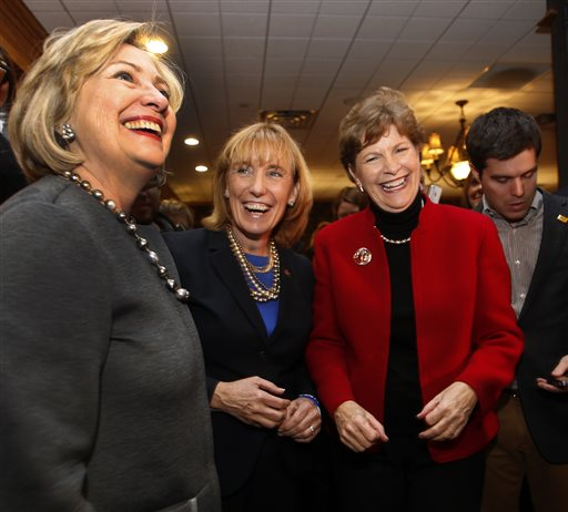 Hillary Rodham Clinton, left, talks to voters with U.S. Sen. Jeanne Shaheen, D-N.H., right, and Gov. Maggie Hassan, D-N.H., at the Puritan Backroom Restaurant  (AP Photo/Jim Cole)