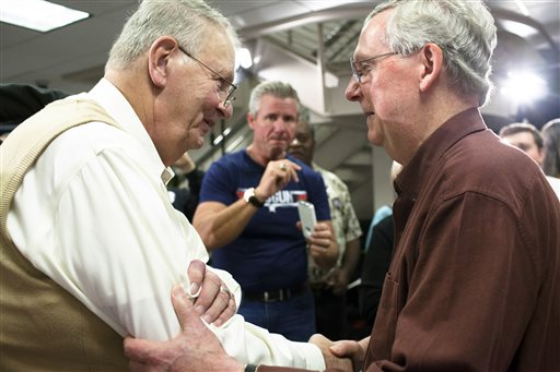 Sen. Mitch McConnell, R-Ky., shakes hands with Jim Johnson of Bowling Green  (AP Photo/ Daily News, Austin Anthony)