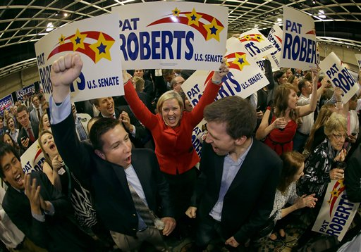 Supporters cheer before Kansas Sen. Pat Roberts makes his victory speech during a Republican watch party Tuesday (AP Photo/Charlie Riedel)