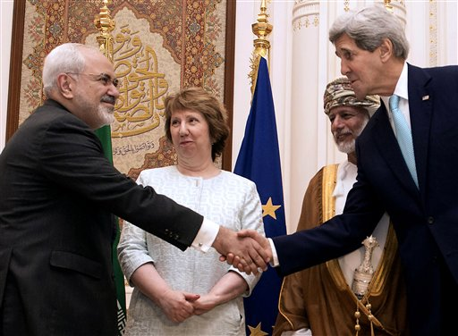U.S. Secretary of State John Kerry, right, and Iranian Foreign Minister Mohammad Javad Zarif, shake hands during a meeting in Muscat, Oman  (AP Photo/Nicholas Kamm, Pool)