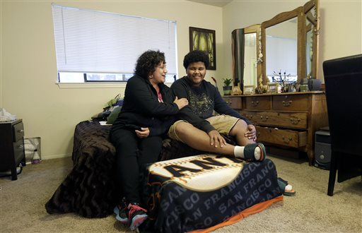 Gina Cooper, left, and her son Dante Walton, 14, at their home in San Carlos, Calif.  (AP Photo/Jeff Chiu)