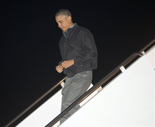 President Barack Obama walks down the stairs of Air Force One  (AP Photo/Pablo Martinez Monsivais)