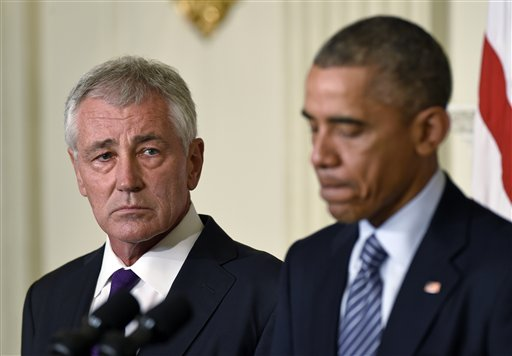Defense Secretary Chuck Hagel, left, listens as President Barack Obama, right, talks about Hagel's resignation  (AP Photo/Susan Walsh)