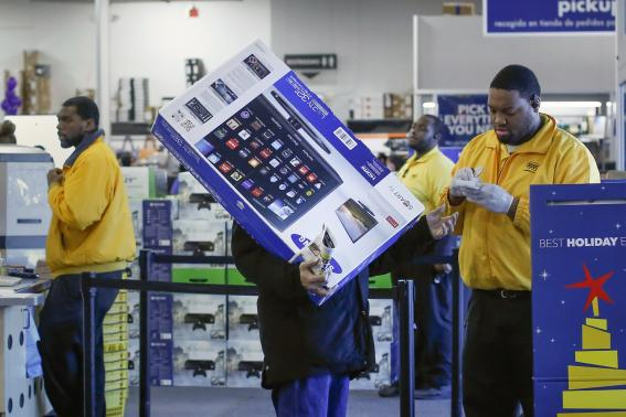 A shopper has his receipt checked before leaving a Best Buy store in Westbury, New York (REUTERS/Shannon Stapleton)