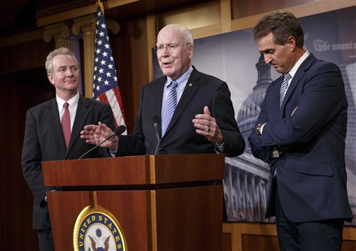 Rep. Chris Van Hollen, D-Md., Sen. Patrick Leahy, D-Vt., and Sen. Jeff Flake, R-Ariz., participate in a news conference on Capitol Hill  (AP Photo/J. Scott Applewhite)