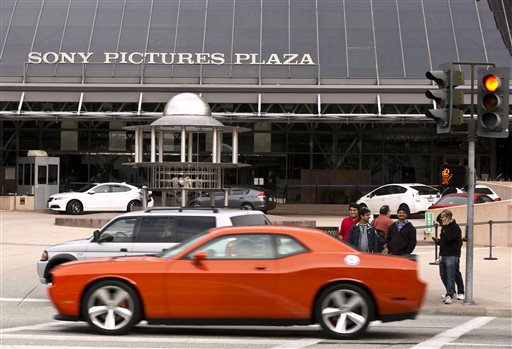 Cars drive by the Sony Pictures Plaza building in Culver City, Calif.  (AP Photo/Damian Dovarganes)