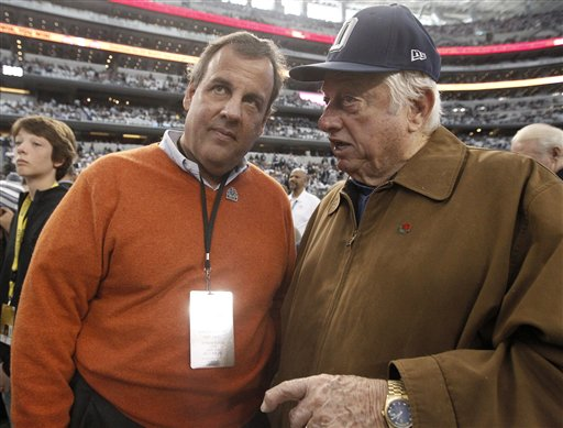 New Jersey Governor Chris Christie and former Los Angeles Dodgers manager Tommy Lasorda talk on the sideline before an NFL wildcard playoff football game between the Dallas Cowboys and the Detroit Lions, Sunday, Jan. 4, 2015, in Arlington, Texas.  (AP Photo/Brandon Wade)