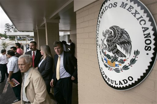 Visitors walk from the Mexican Consulate in Little Rock, Ark.  (AP Photo/Danny Johnston)